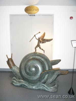 snail sculpture shown blocking the gallery doors