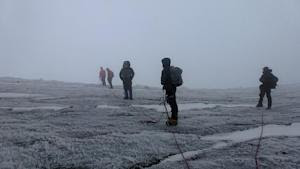 Mountain climbers head to the top of Mount Stanley…