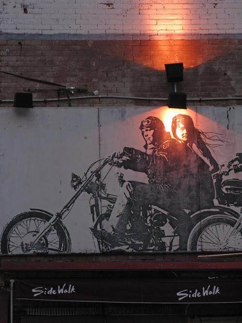 light on mural signage above Side Walk, Manhattan, NYC