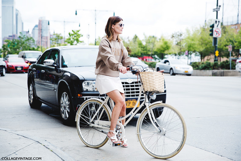 New_York_Fashion_Week_Spring_Summer_15-NYFW-Street_Style-Hanneli_Mustaparta-Bike-White_Skirt-Sweatshirt-1