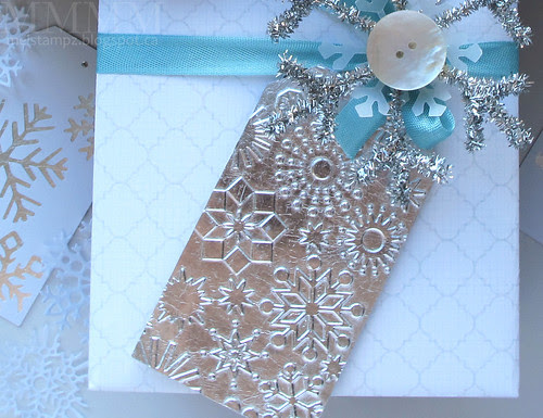 embossed silver gilded paper tag