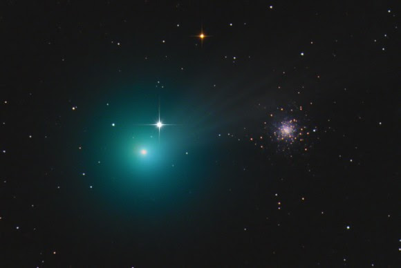 Another striking image of the comet's juxtaposition with the globular cluster M79. Lovejoy is presently 48 million miles from Earth; the cluster shines from the immense distance of 410,000 light years. Credit: Chris Schur