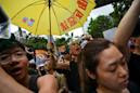 Protesters unmoved as Hong Kong leader says China extradition bill 'dead'