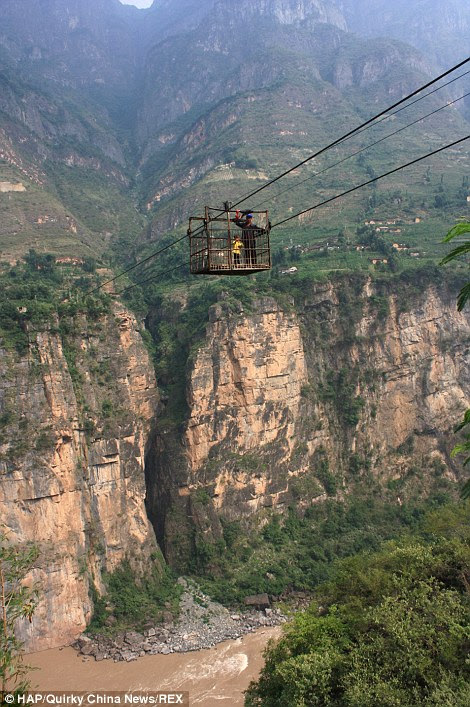 The Yin'ge 'strop ropeway' which connects two villages in China