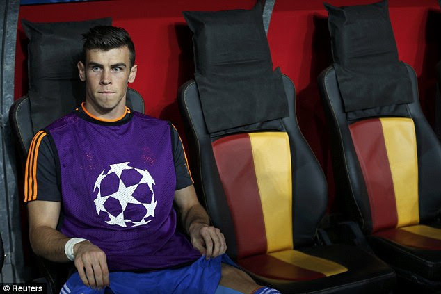 Benched: Gareth Bale watched the first half of the match from the sidelines