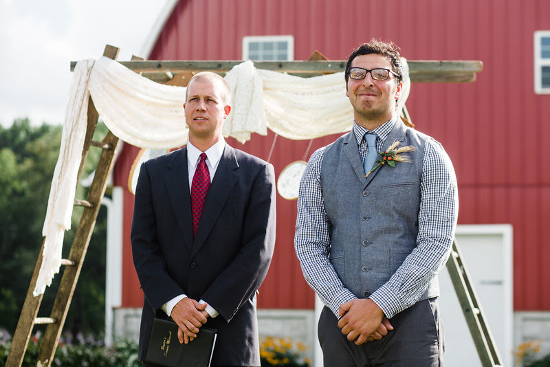 A country chic / rustic wedding ceremony at Busy Barns Adventure Farms in Fort Atkinson Wisconsin about 30 minutes east of Madison and an hour north of Chicago. Photo by Mindy Joy Photography.