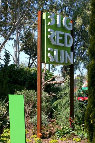 big red sun sign