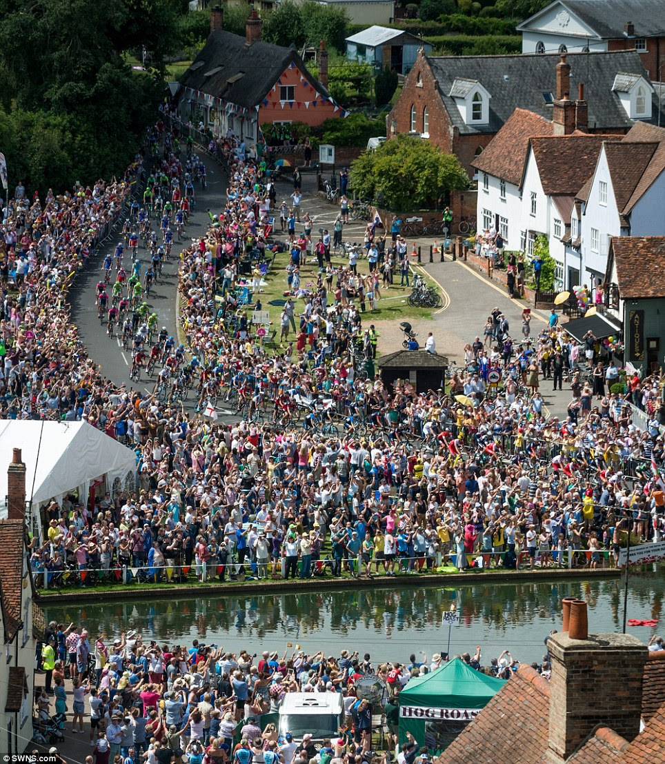 Glorious sight: The Tour de France goes through the picturesque village of Finchingfield, near Braintree in Essex