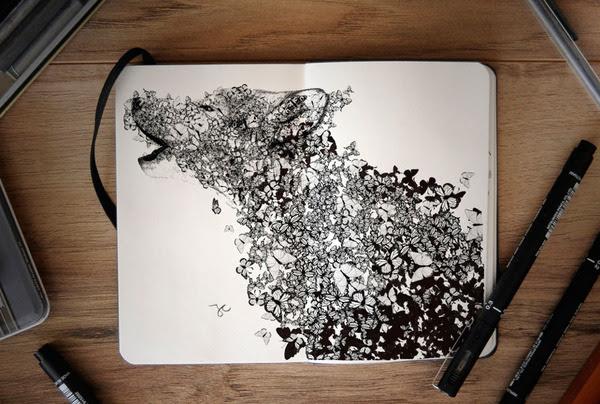 手帳ほどのスケッチブックに描く動物や植物をモチーフにしたイラスト