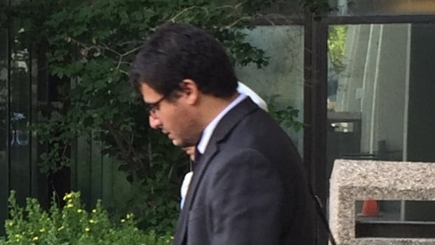 Dr. Ismail Taher leaves court with his wife while awaiting sentencing for sexual assault and assault convictions.