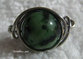 top view of wire wrapped ring with green stone (no name)