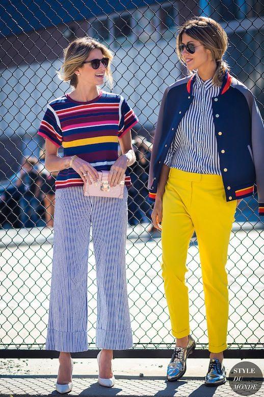 Le Fashion Blog Summer Street Style Bright Striped Top Varsity Jacket Statement Pants Mini Clutch Pinstripe Pumps Metallic Oxfords Via Style Du Monde