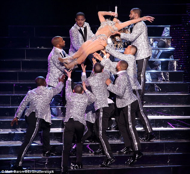 Carry me: She was lifted gracefully up the stage stairs by the male dancers