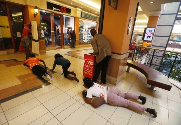 People scramble for safety as armed police hunt gunmen who went on a shooting spree at Westgate shopping centre in Nairobi, September 21, 2013. The gunmen stormed a shopping mall in Nairobi on Saturday killing at least 20 people in what Kenya's government said could be a terrorist attack, and sending scores fleeing into shops, a cinema and onto the streets in search of safety. Sporadic gun shots could be heard hours after the assault started as soldiers surrounded the mall and police and soldiers combed the building, hunting down the attackers shop by shop. Some local television stations reported hostages had been taken, but there was no official confirmation. REUTERS/Goran Tomasevic (KENYA - Tags: CIVIL UNREST)