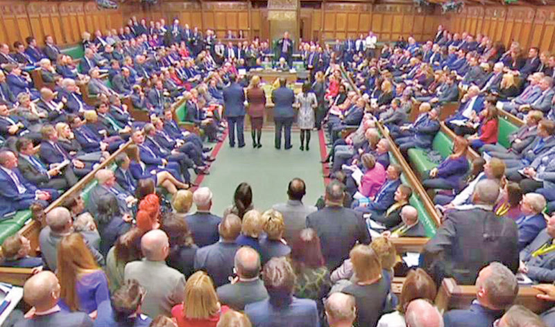 A video grab from footage broadcast by the UK Parliament's Parliamentary Recording Unit shows MPs in the House of Commons in London on Tuesday.