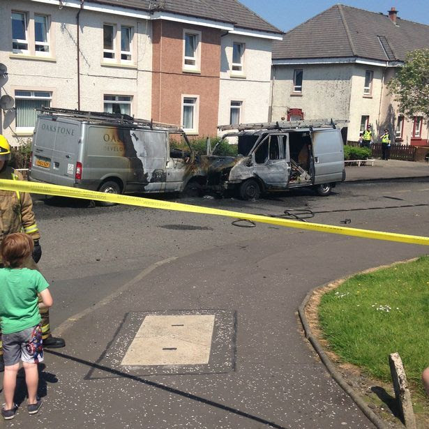 Burnt-out vans at the scene