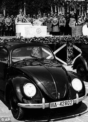 Nazi favourite: Hitler speaks at the opening ceremony of the Volkswagen car factory in Fallersleben, Germany, in 1938. Volkwagen used 12,000 slave labourers under the Nazis