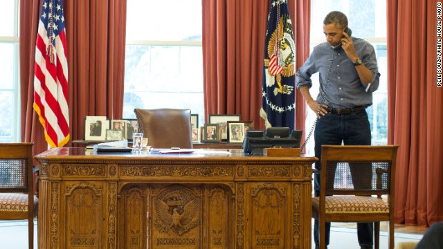 U.S. President Barack Obama talks on the phone in the Oval Office with Russian President Vladimir Putin about the situation in Ukraine, March 1