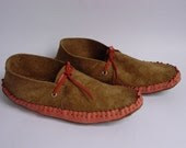 Warm brown suede and coral colored moccasins