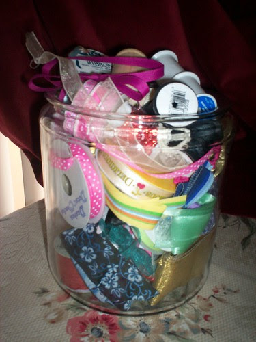 Thirfted jar filled with ribbon