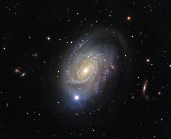 This VLT image shows the spiral galaxy NGC 4981. The bright star visible in the image is a foreground star. Image credit: ESO / Josh Barrington.