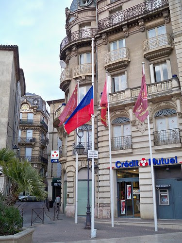 Beziers Town Hall with the Haitian  Flag at half mast.