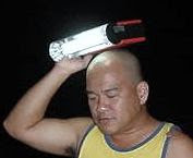 NoHair holding a light over his head