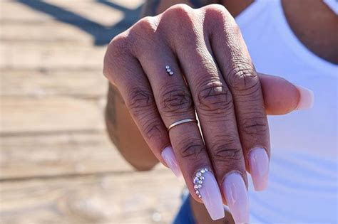 People are piercing their fingers instead of wearing