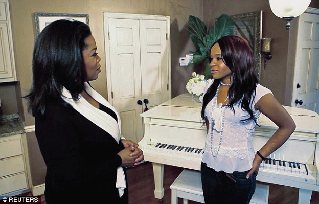 Daughter's loss: Oprah Winfrey talks with Bobbi Kristinaduring a March 2, 2012 taping of an interview in Atlanta following Whitney Houston's death