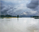 SUKKUR - August 2: A view of approaching clouds over still waters of the Indus.—Dawn