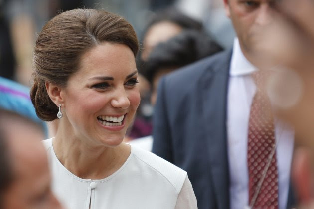 Catherine, Britain's Duchess of Cambridge, smiles at well-wishers at KLCC Park in Kuala Lumpur