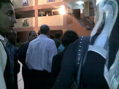 Former minister and long time Agouze and Dokki representative in the parliament Amal Othman from the back. You can see her back
