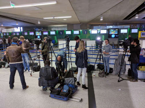 Reporters gather in front of the EgyptAir counter at Charles de Gaulle Airport outside of Paris on Thursday, May 19, 2016. An EgyptAir flight from Paris to Cairo carrying 66 people disappeared from radar early Thursday morning, the airline said. (AP Phot