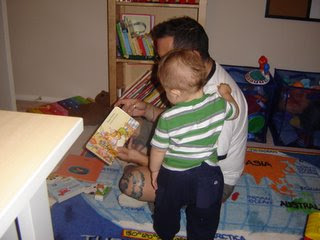 Ed and Santiago reading a book.