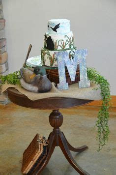 Drew's cake table. MSU, hunting, and rustic themed, with