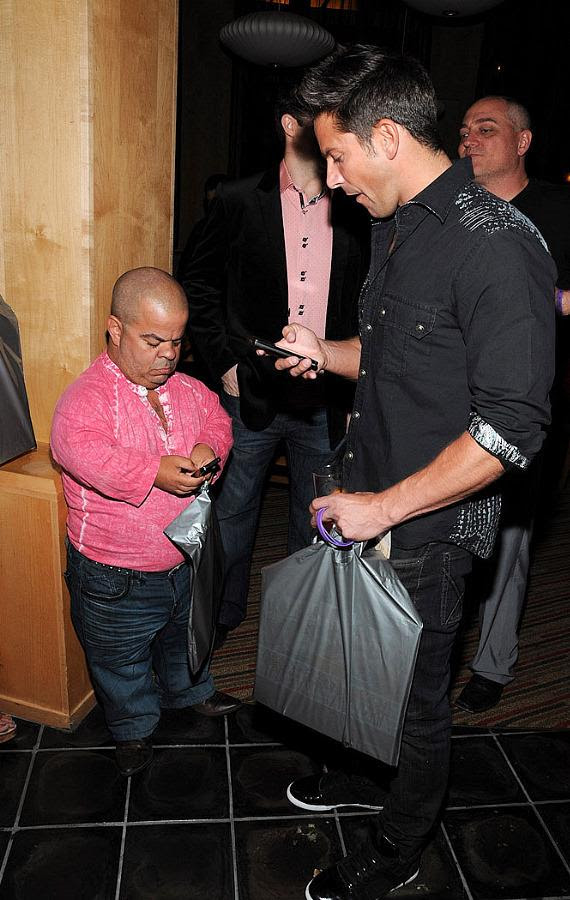 """Brian Thomas and Jeff Timmons check their phones at """"Ultimate FANTASY"""" calendar party"""