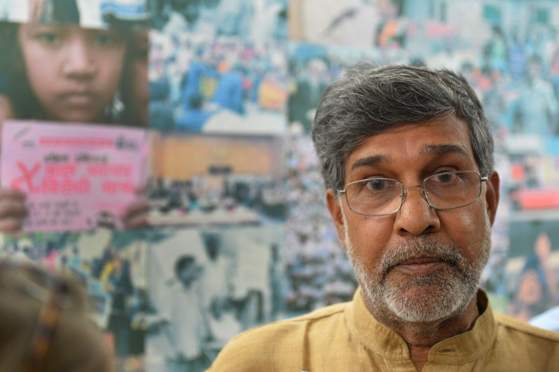 Kailash Satyarthi gestures at his home office