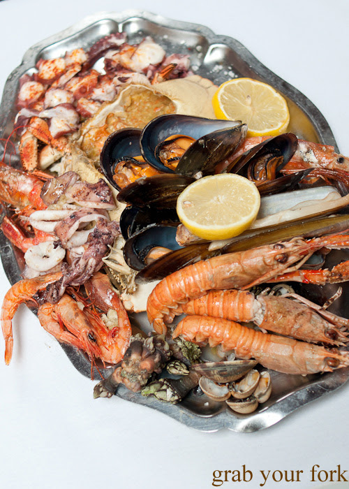 Grilled shellfish and octopus platter from O Paladar seafood restaurant, A Coruna, Galicia, Spain