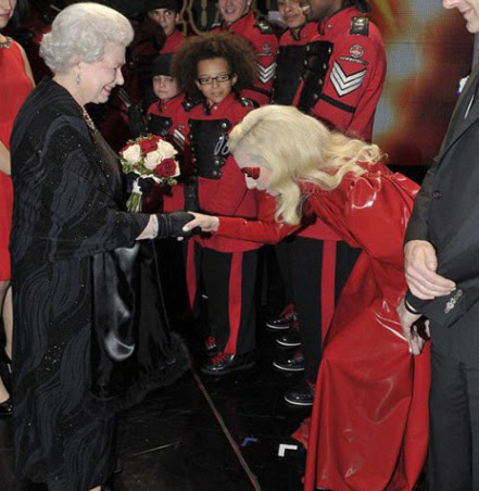 lady gaga meeting the queen in an unusual satanic outfit