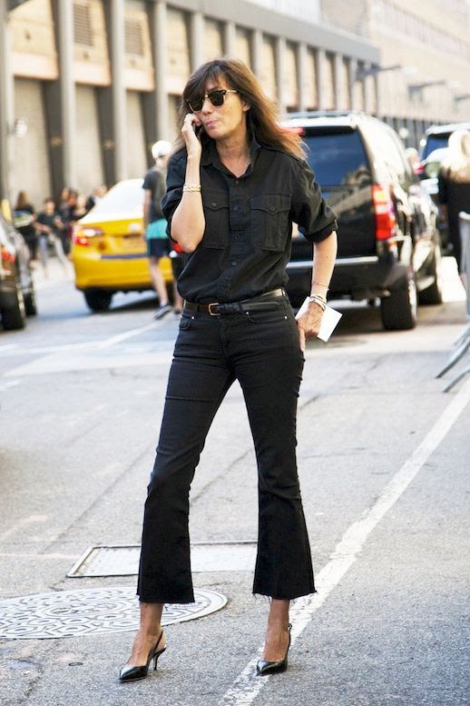 Le Fashion Blog Fall Editor Style Emmanuelle Alt All Black Look Button Down Shirt Bracelets Cropped Flare Raw Hem Jeans Leather Slingback Heels Via The Outfit