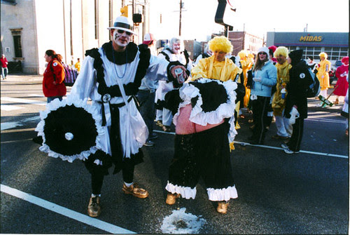 1 mummer pouring bud on another mummers ass copy 1