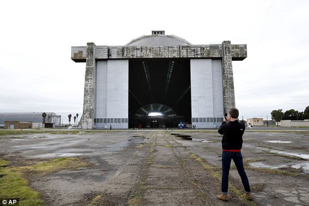 Impressive: Bradley Hasemeyer, the host of AOL's Translogic show, uses his smartphone to photograph the Aeroscraft airship inside its colossal hangar at the former Tustin Marine Corps Air Station in Orange County