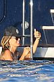 heidi klum rinses off in tiny colorful bikini with roses at her feet 05