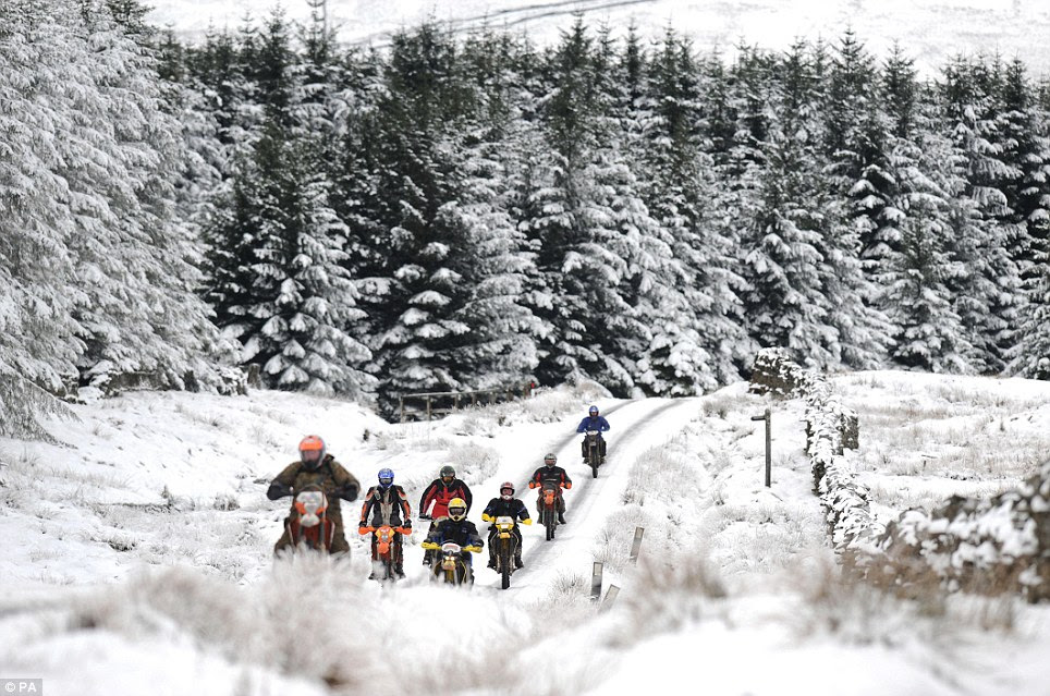 Easy does it: Cross country motorcyclists ride carefully in a line as they make their way up a track in Nenthead, Cumbria