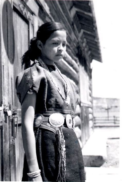 Navajo girl wearing traditional rug dress, sash belt and