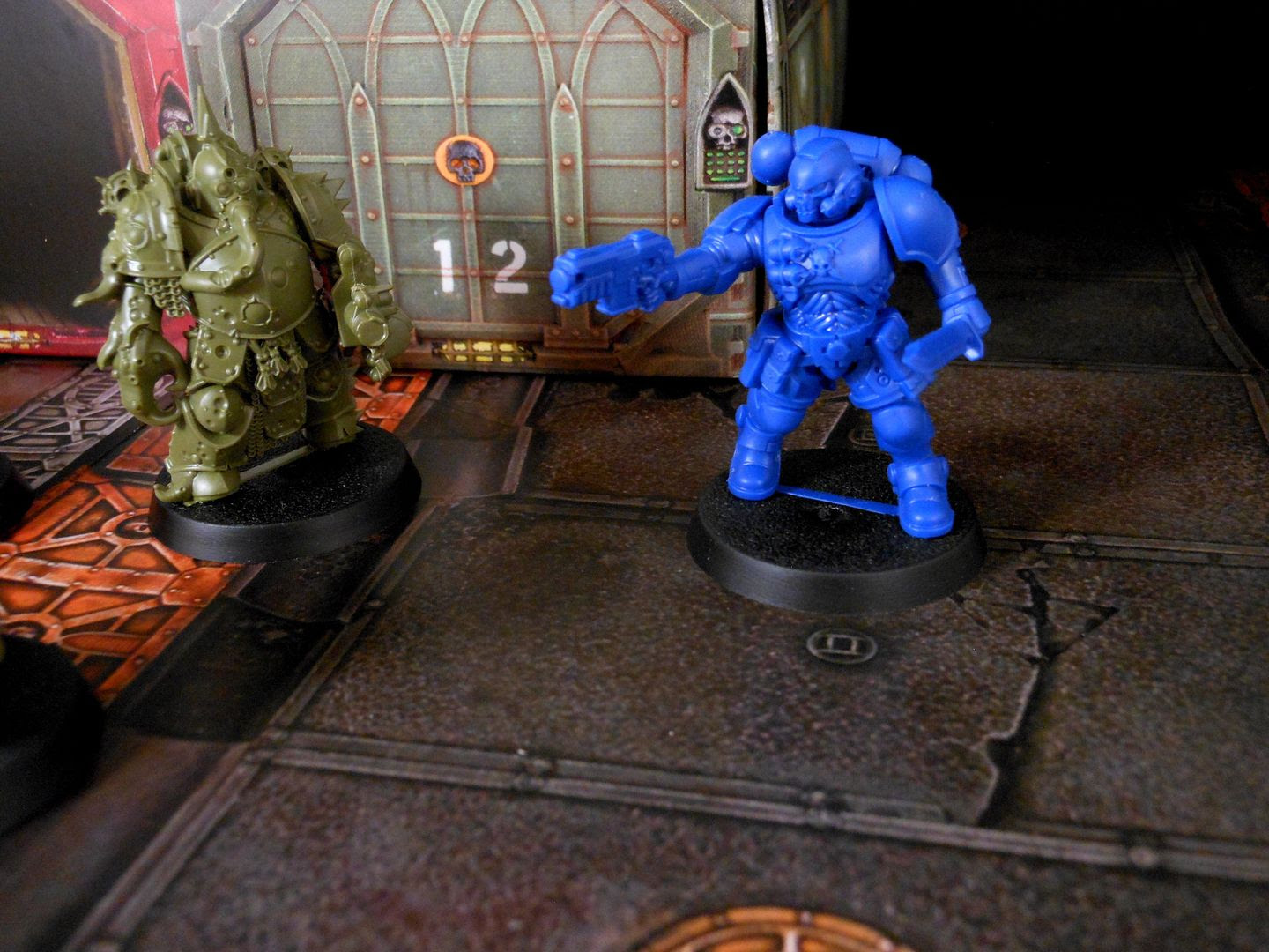 A Reiver Space Marine attacks a Death Guard Marine in Warhammer 40,000: First Strike.