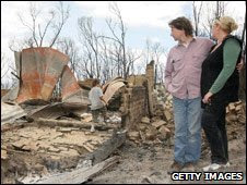 Surveying destroyed homes