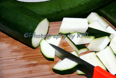 zucchini and knife on a cutting board