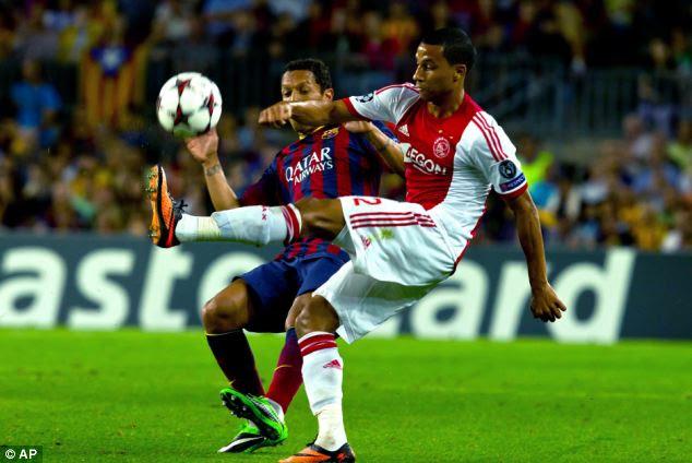 Tussle: Barcelona defender Adriano attempts to block Ajax's Ricardo van Rhijn