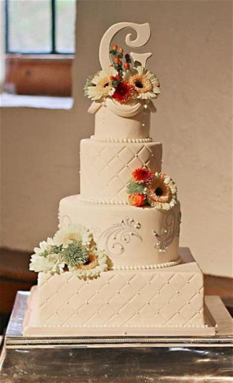 4 tier ivory wedding cake with square and round